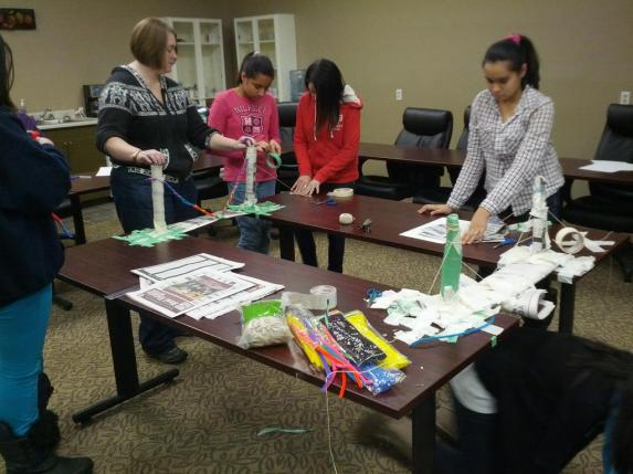 Girls Inc building newspaper bridges